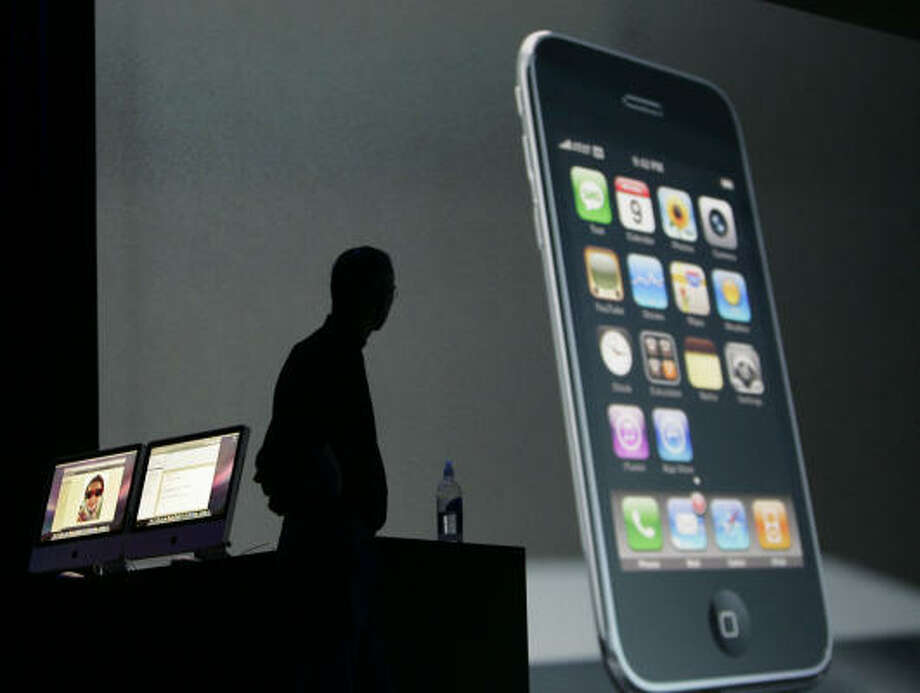 Apple CEO Steve Jobs announces the new Apple iPhone 3G at the Apple Worldwide Developers Conference in San Francisco. Photo: Paul Sakuma, AP