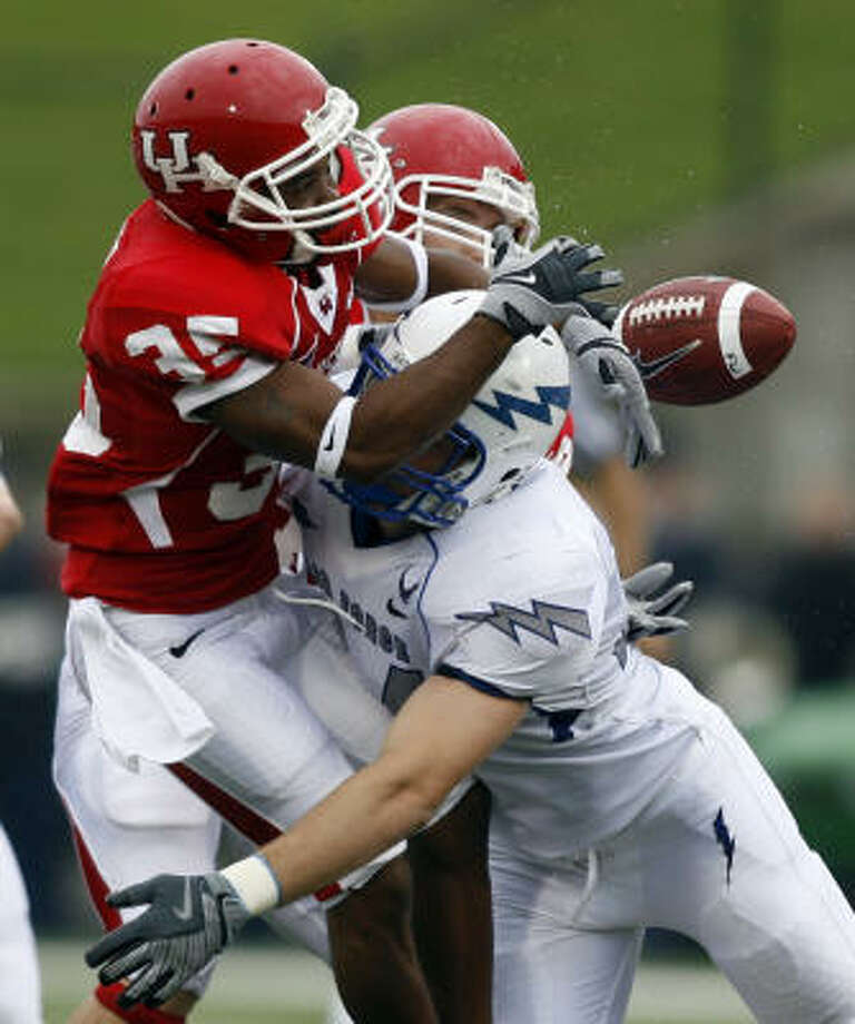 UH's Tyron Carrier coughs up the ball. Photo: Mike Stone, AP