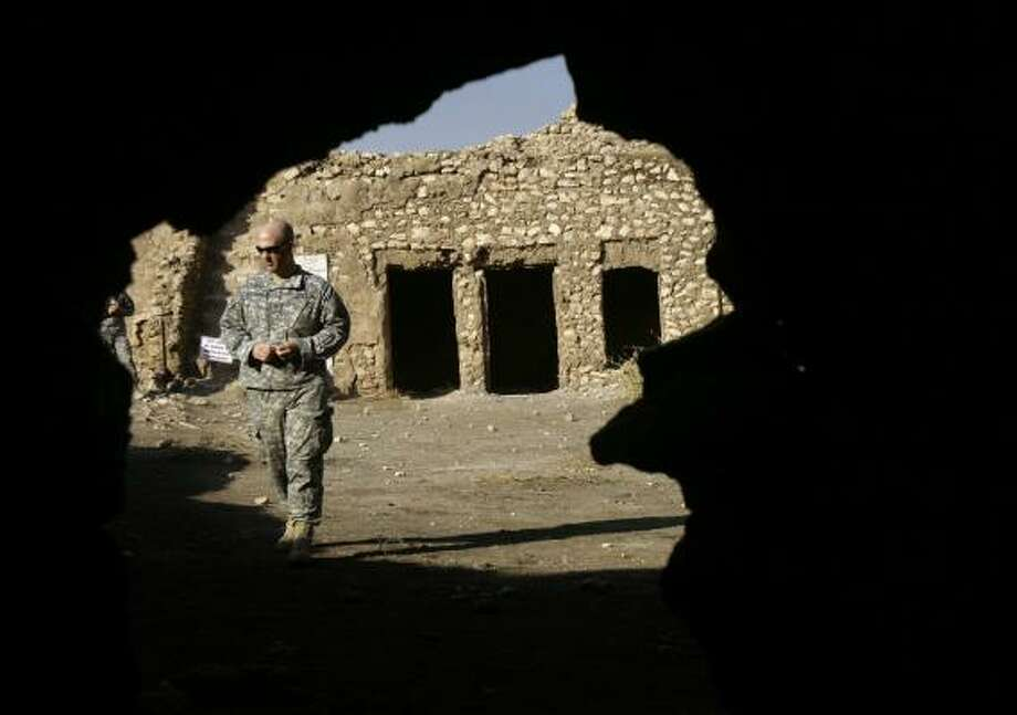 "U.S. soldiers take a guided tour of St. Elijah's Monastery in Mosul, Iraq. The tour is ""a break for the soldiers and gives Iraq, the people, a human face,"" Capt. Geoffrey Bailey said. Photo: MAYA ALLERUZZO, ASSOCIATED PRESS"