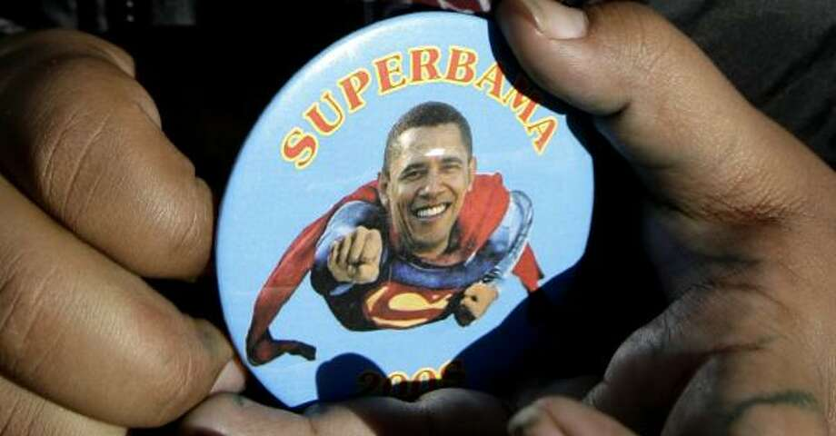 "A button portraying Barack Obama as Superman plays to his geeky side. But at least one professor of science says the president-elect is ""too cool to be a geek."" Photo: SETH WENIG, ASSOCIATED PRESS FILE"