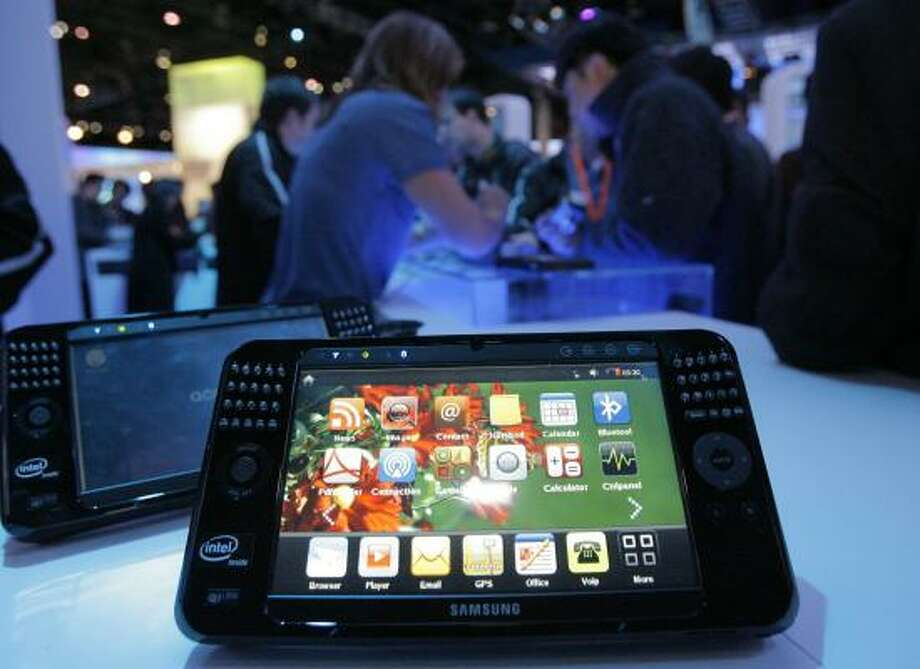"""Samsung's mobile Internet device offering is on display at Intel's booth at the International CES in Las Vegas on Monday. Intel is betting on a big expansion of """"ultra-mobile"""" computing. Photo: JAE C. HONG, ASSOCIATED PRESS"""