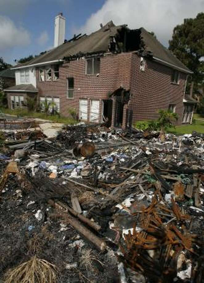 The June 2007 fire destroyed the Medina home and burned two adjacent residences. Photo: STEVE UECKERT, CHRONICLE FILE