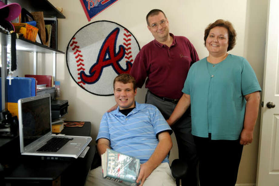Chris Johnson, 17, left, with his parents, Mark and Debbie Johnson, has made the most of his high school career at St. Pius after Hurrican Katrina forced his family to relocate to Houston. Photo: Jerry Baker, For The Chronicle