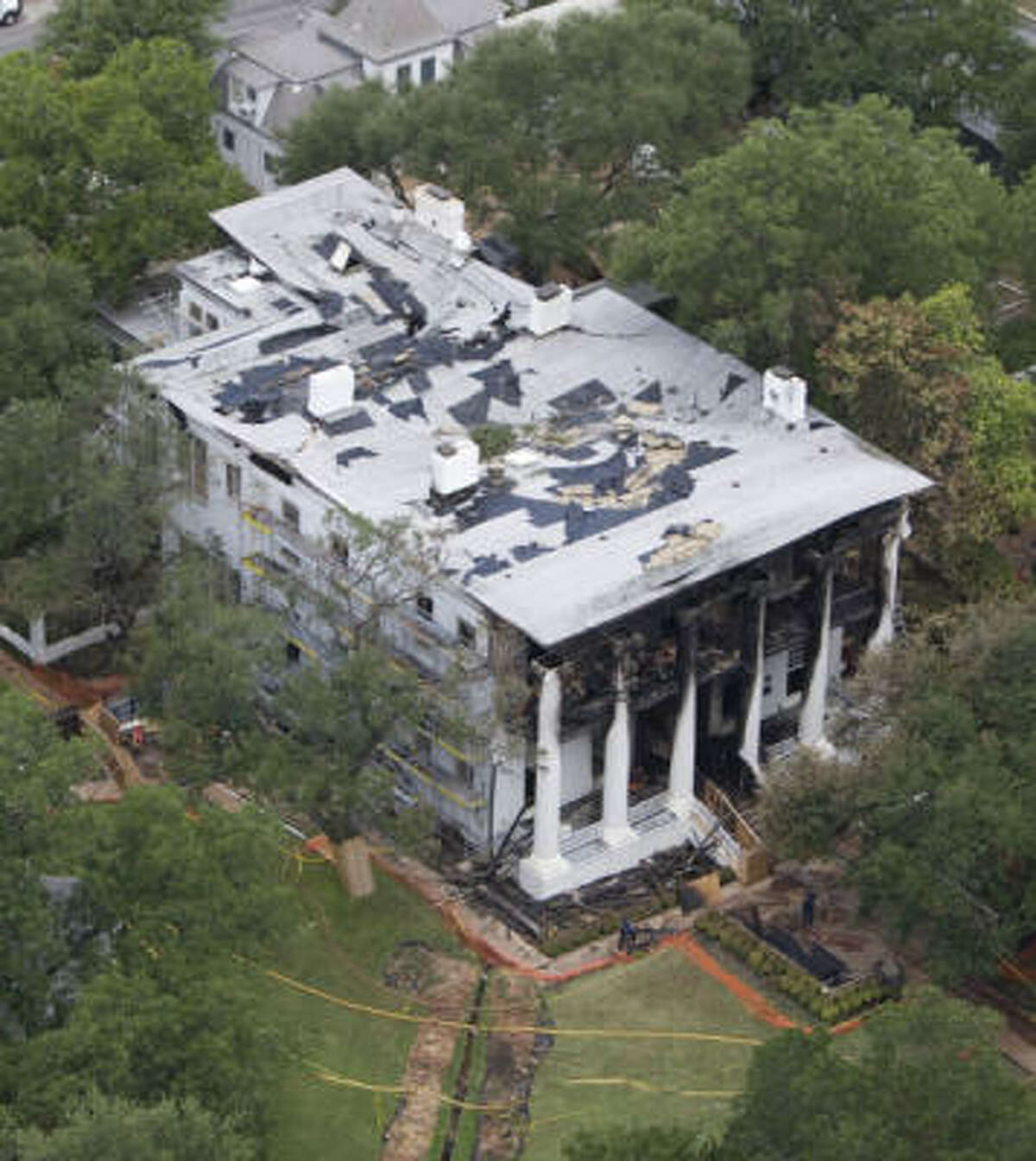 An aerial view reveals the destruction to the Governor's Mansion on Sunday in Austin. Bob Daemmrich : bob@bobphoto.com