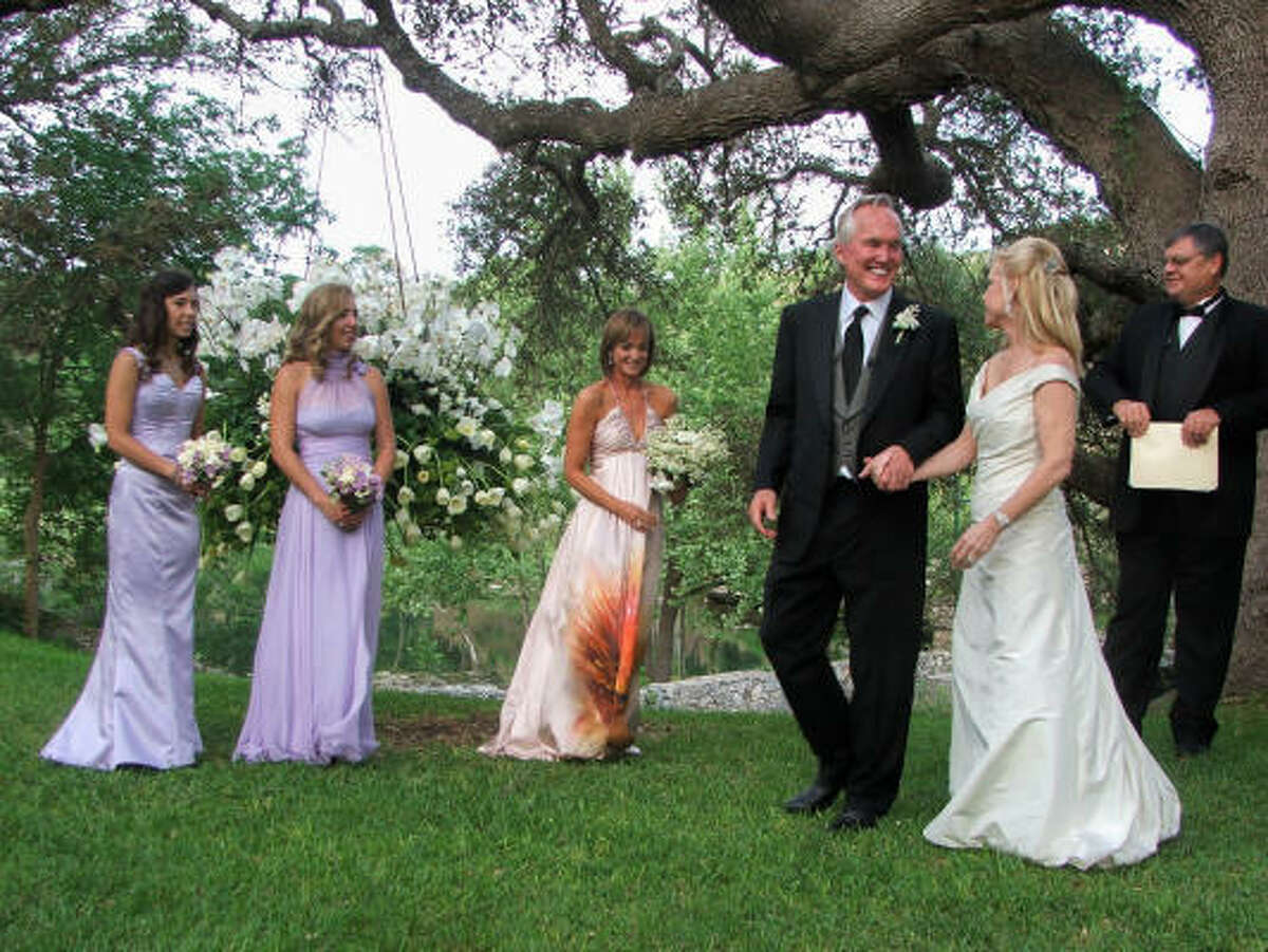 Wedding attendants Dominique Dawley, from left, Danielle Dawley and Janet Gurwitch stood in honor of the happy couple, Susanne Dawley and John Byram. Judge Dan Mills performed the ceremony at Byram Ranch outside of Austin.