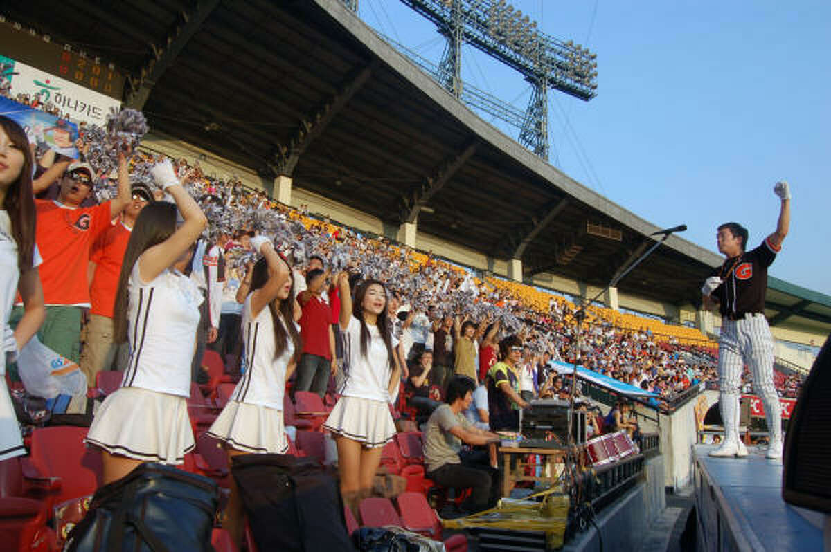 The Lotte Giants cheerleaders work the crowd during a recent baseball game in Seoul, South Korea.