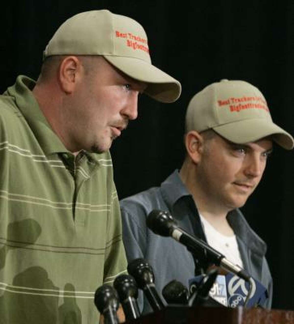 Rick Dyer, left, and Matthew Whitton answer questions during a news conference Friday at which they claimed to have a dead Bigfoot in their possession.