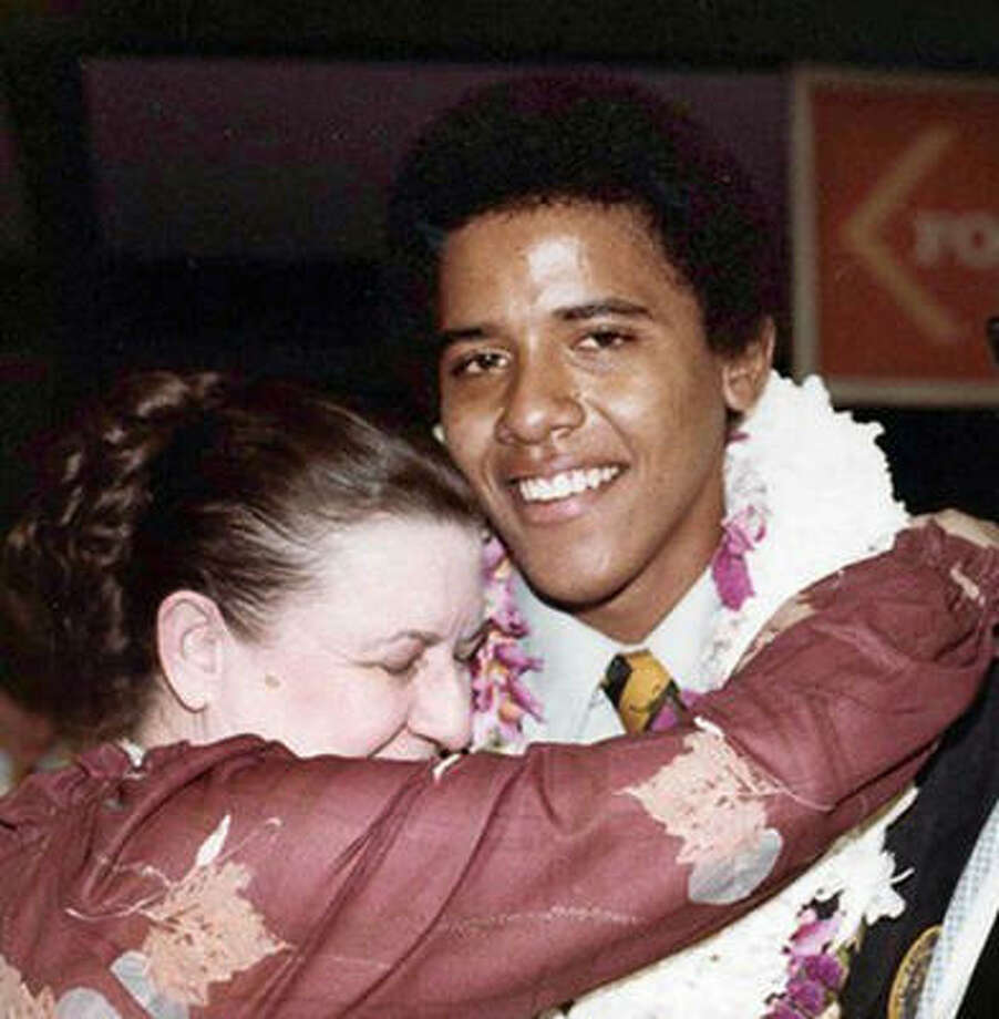 This photo provided by the presidential campaign of Barack Obama shows Obama in 1979 during his high school graduation in Hawaii with his grandmother Madelyn Lee Payne Dunham. Photo: AP