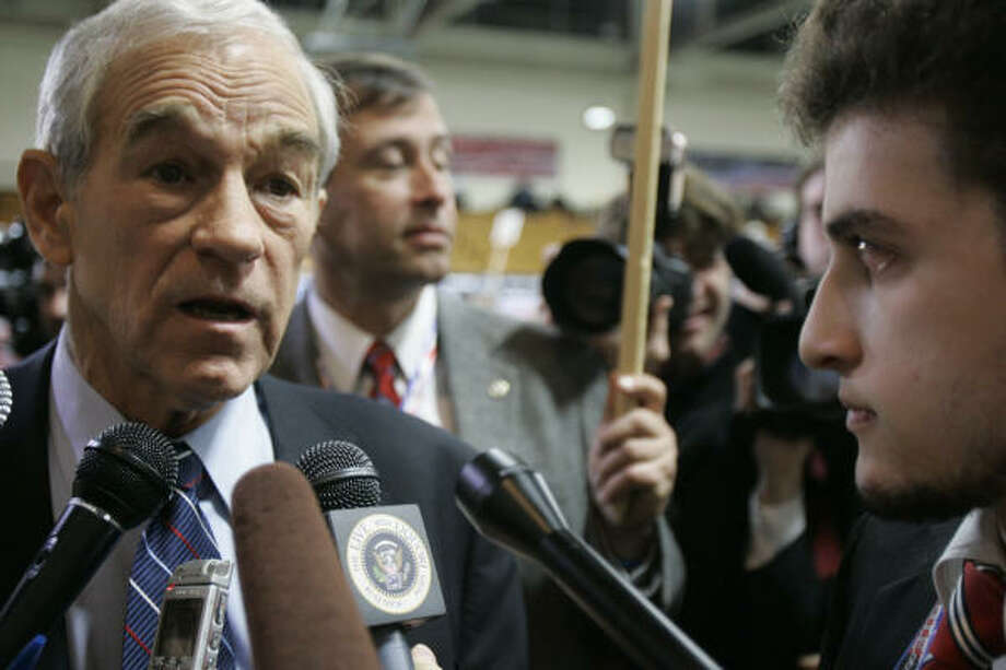 Republican presidential hopeful Rep. Ron Paul, R-Texas, speaks to reporters in the spin room after participating in the New Hampshire debates Saturday. Photo: M. Spencer Green, AP