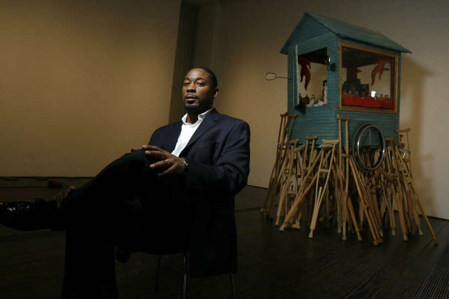 A snow-cone cart and crutches comprise Pepon Osorio's Lonely Soul. Menil curator Franklin Sirmans, pictured, sees the work as a hybrid. Photo: Sharon Steinmann, Chronicle