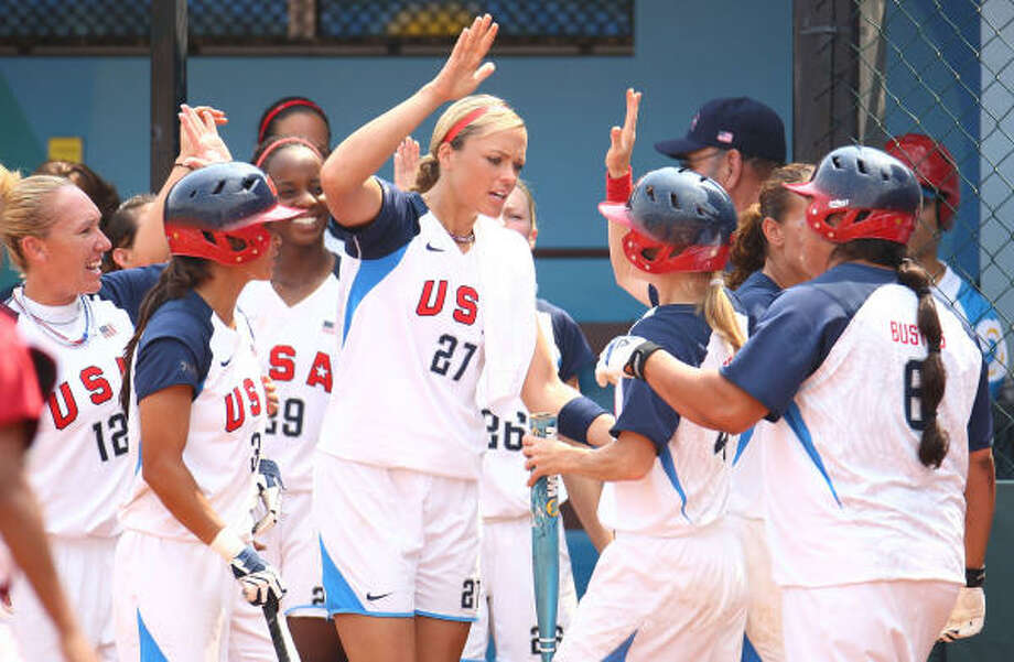 Pitcher Jennie Finch (No. 27) congratulates her teammates on their way to defeating Venezuela 11-0 during their preliminary softball game at the Fengtai Sports Center Softball Field during Day 4 of the Beijing 2008 Olympic Games. Photo: Vladimir Rys, Bongarts/Getty Images