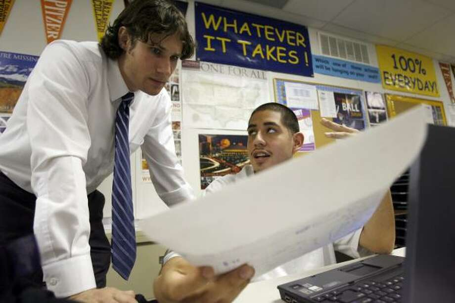 YES counselor Chad Spurgeonbassists Victor Gutierrez, 18, with a scholarship application. Photo: JOHNNY HANSON, CHRONICLE