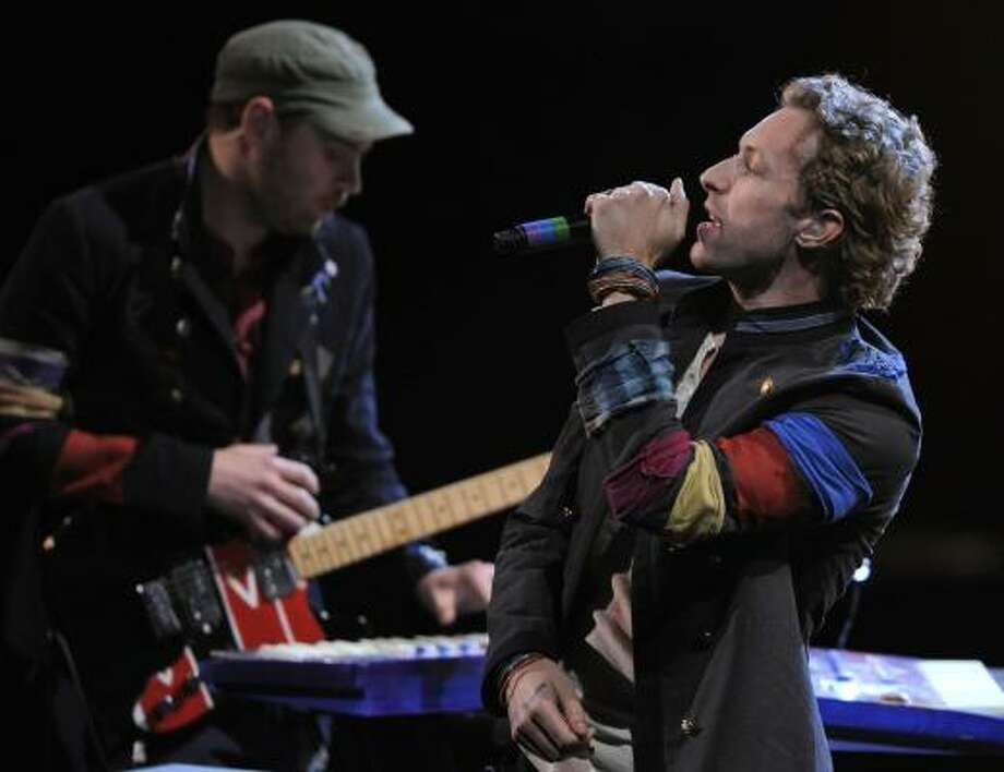 Coldplay singer Chris Martin and crew have enlisted co-producers Markus Dravs (Björk, Arcade Fire), Rik Simpson and Jon Hopkins to frame musings on life, death and love for their new album, Viva la Vida or Death and All His Friends. Photo: MARK J. TERRILL, ASSOCIATED PRESS