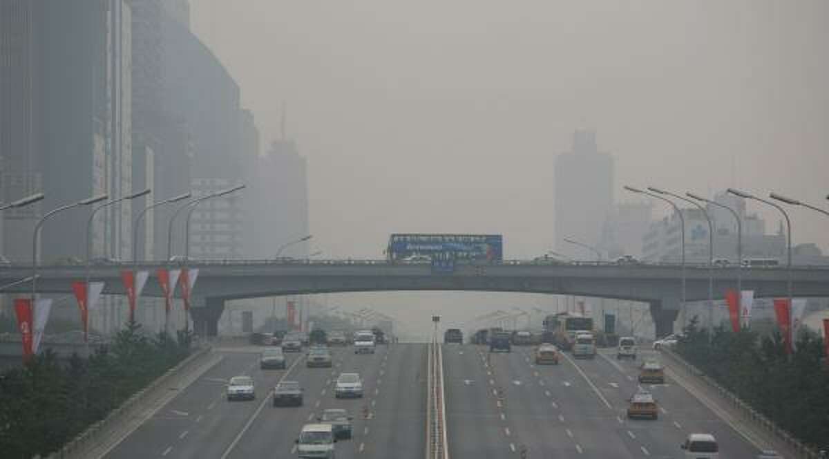 Smog chokes Beijing on Monday. Olympians are concerned about how air quality will affect their health and performance.