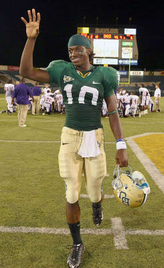 Baylor University quarterback Robert Griffin is young but is no stranger to pressure-packed events. After going through spring football, he won the 400-meter hurdles at the Big 12 championships in May and finished third at the NCAA outdoor meet. He also competed at the U.S. Olympic Trials. Photo: Jerry Larson, AP