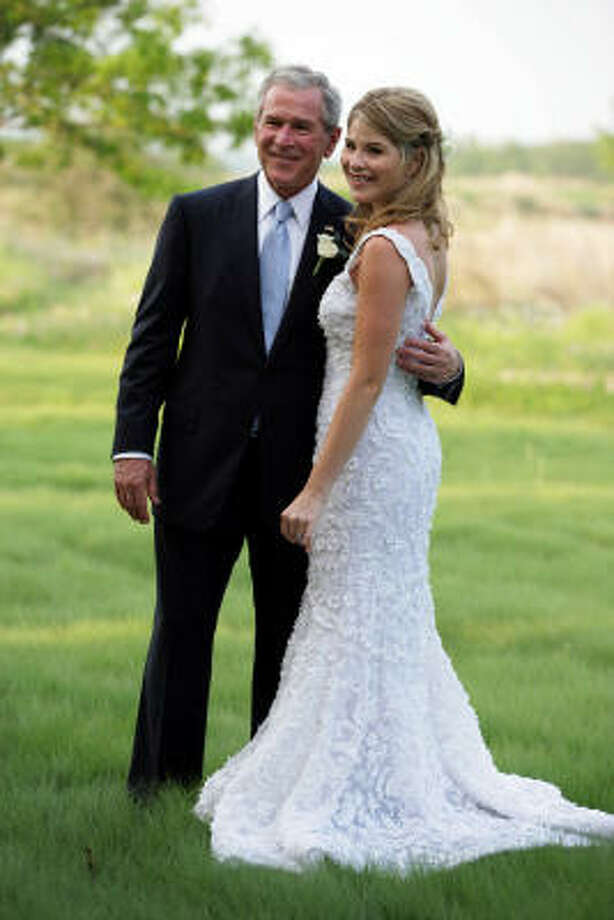 President George W. Bush gets ready to walk daughter Jenna Bush down the aisle before her wedding to Henry Hager at Prairie Chapel Ranch in Crawford. Photo: SHEALAH CRAIGHEAD, AFP/Getty Images