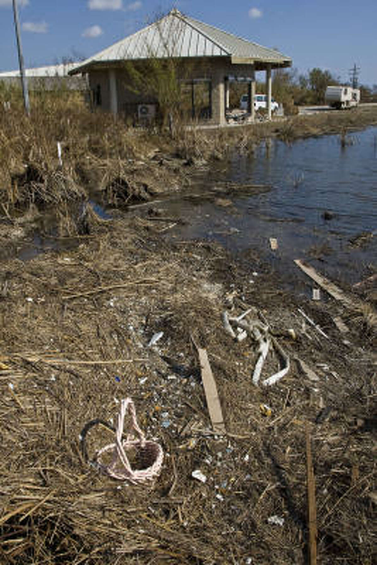 An Easter basket and other debris deposited by Hurricane Ike rests in the pond outside the Visitor Center at the Anahuac National Wildlife Refuge. .