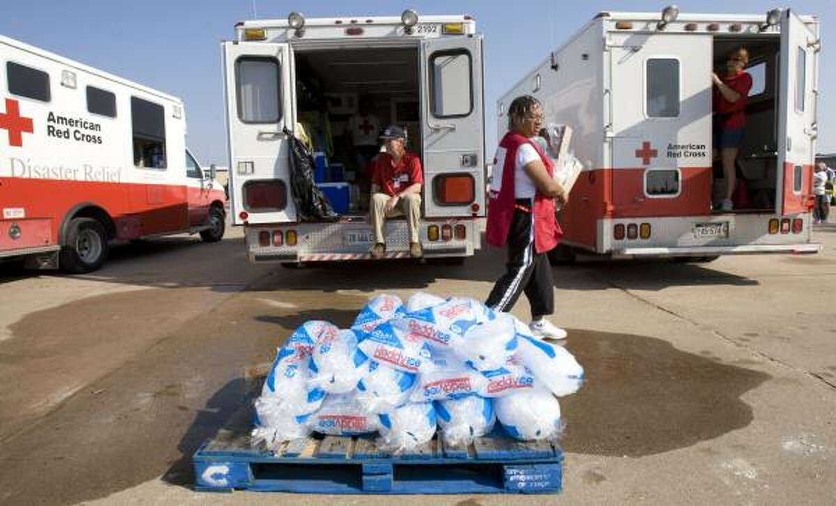 Red Cross volunteers prepare Thursday to take meals to people in Galveston.