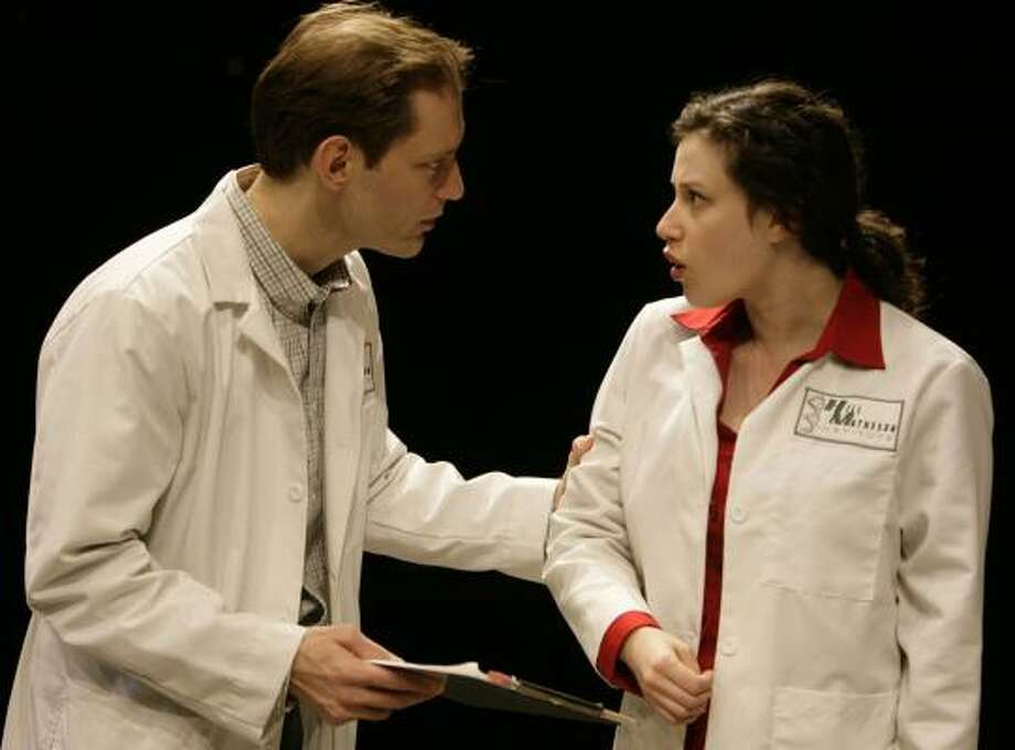 Young researcher William Shumway (Dylan Chaffy) confronts graduate student Alice Curitan (Melissa Miller) in the biomedical thriller Secret Order. Photo: ERIC KAYNE, CHRONICLE