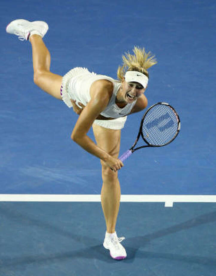 915b832034c9 Maria Sharapova blasts a serve during her womens singles semifinal match  against Jelena Jankovic. Photo
