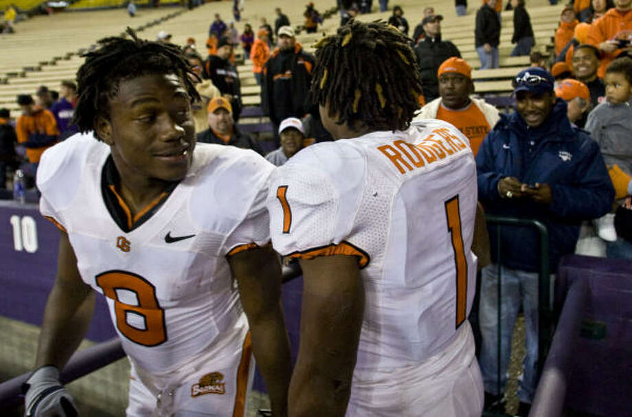 James, left, and Jacquizz Rodgers have rewarded Oregon State for having faith that they could play bigger in college than their 5-7 statures indicated. Photo: John Froschauer, AP