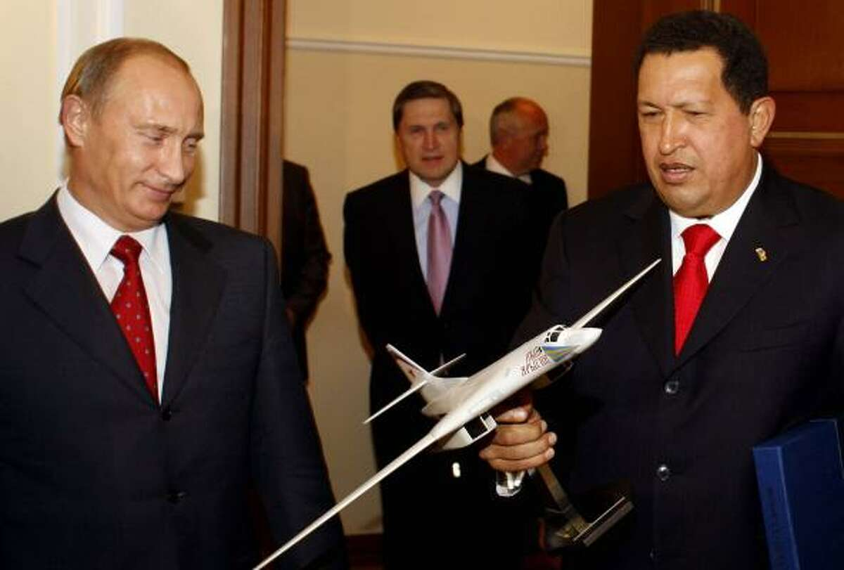 Venezuelan President Hugo Chavez holds a replica of a Russian bomber as he talks with Russian Prime Minister Vladimir Putin in Moscow last month. Chavez is using the relationship with Russia as a way to diminish U.S. influence in Latin America. Other nations in the region also are seeking military ties to Moscow.