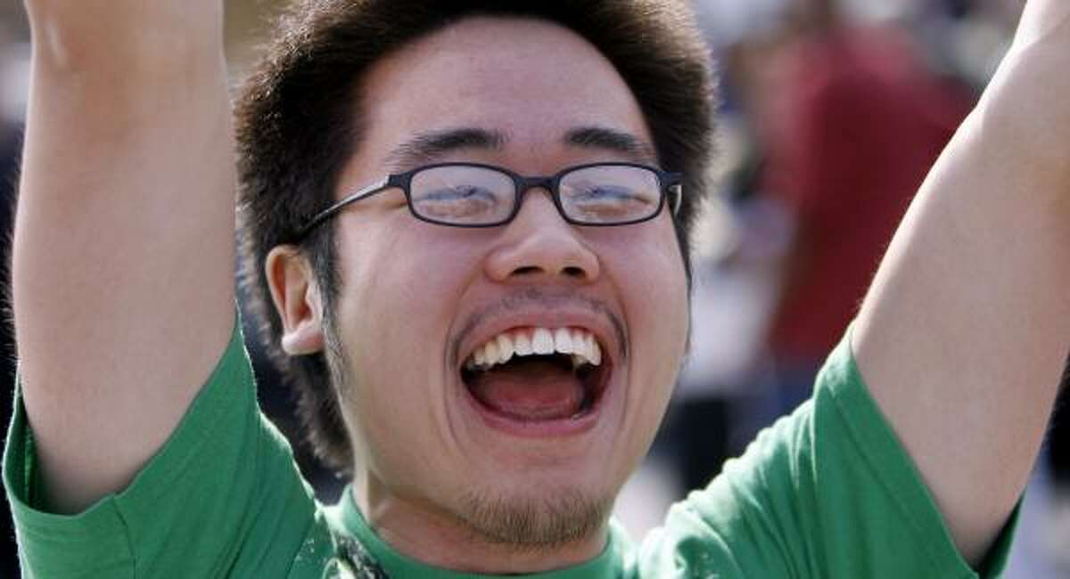 """Michael Chou, 21, Cheers at an Obama rally """"What's most important is fixing foreign policy,"""" he says."""