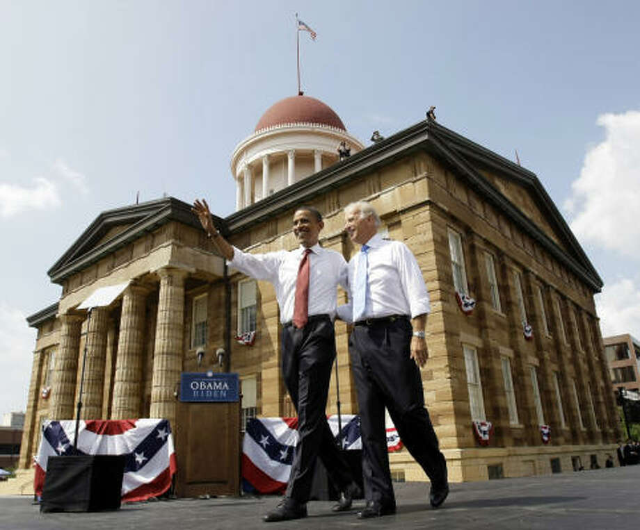 Democratic presidential candidate Sen. Barack Obama, D-Ill., walks with vice presidential running mate Sen. Joe Biden, D-Del., at a rally in front of the Old State Capitol in Springfield, Ill., on Saturday, Aug. 23, 2008. Photo: Alex Brandon, AP