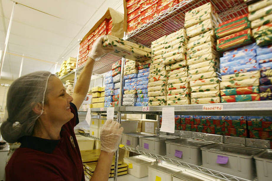 Stephanie Biffle, store manager at Kegg's Candy, fills an online order of chocolates. Photo: Mayra Beltran, Houston Chronicle