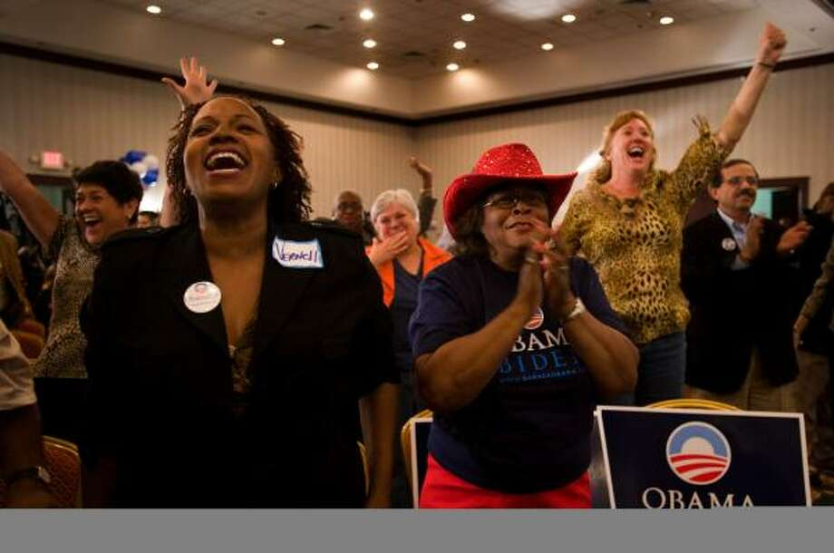 Vernell Jackson, left, and Gloria White cheer as reports show Barack Obama leading in early returns Tuesday at the election night watch party held by Harris County Democrats at the Crowne Plaza. Photo: SMILEY N. POOL, CHRONICLE