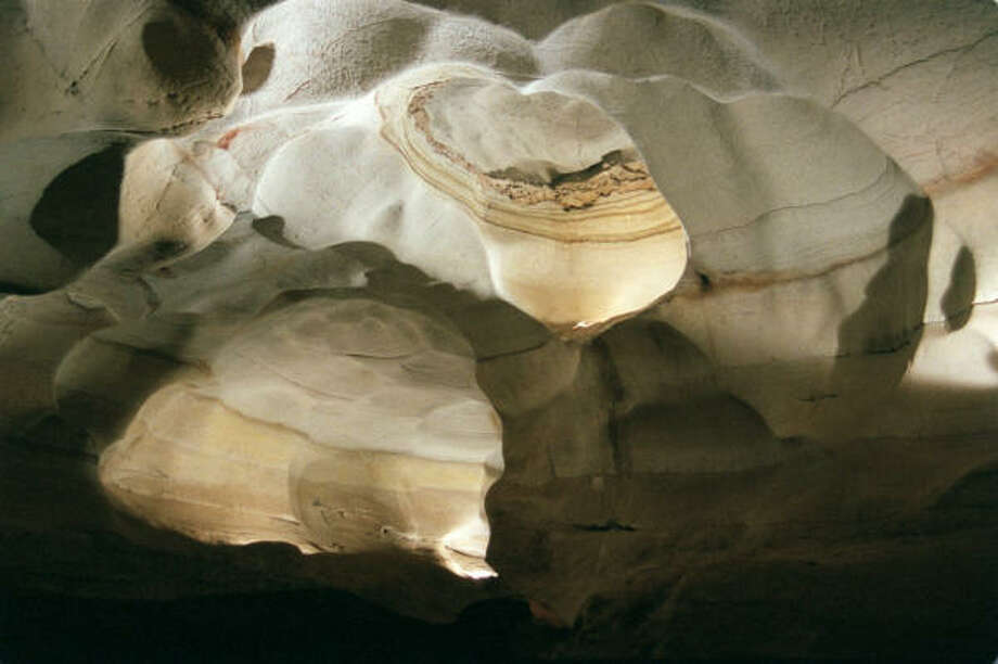 At Longhorn Cavern State Park, the smooth limestone walls and a limestone ceiling resemble marble. Photo: Ed Erwin, For The Chronicle