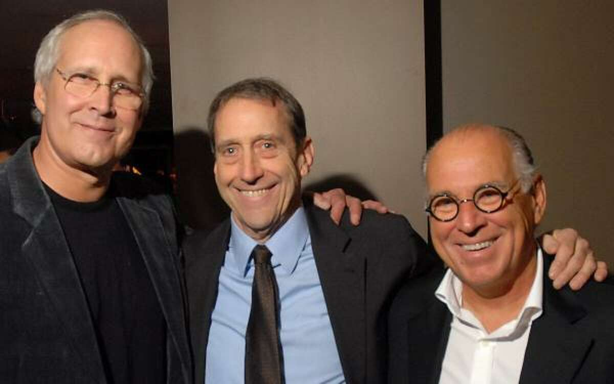 Collectors Chevy Chase, left, and Jimmy Buffett, right, joined artist John Alexander on Friday night at the Hotel ZaZa dinner that followed the opening of his retrospective exhibition at the Museum of Fine Arts, Houston.