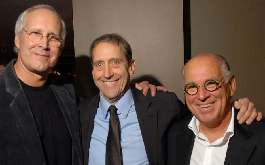 Collectors Chevy Chase, left, and Jimmy Buffett, right, joined artist John Alexander on Friday night at the Hotel ZaZa dinner that followed the opening of his retrospective exhibition at the Museum of Fine Arts, Houston. Photo: DAVE ROSSMAN, FOR THE CHRONICLE