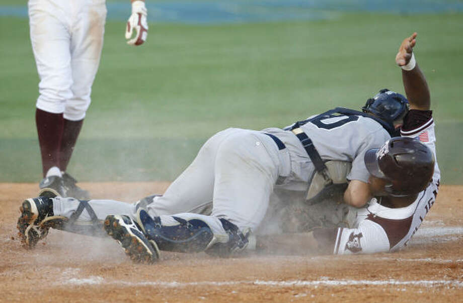 Adam Zornes, top, tags out A&M runner Kyle Colligan at home on a bases loaded steal attempt in the fourth inning. Photo: Karen Warren, Chronicle