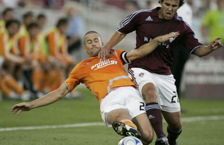 The Dynamo's Wade Barrett and Rapids' John Diraimondo fight for possession in the first half. Photo: Will Powers, AP