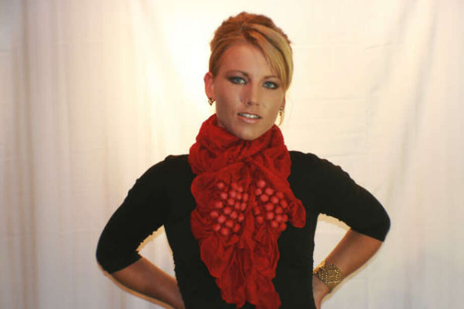 This red shawl, $89, from BB1 classic is a great way to dress up the little black dress for the holidays. Photo: BB1 Clasic