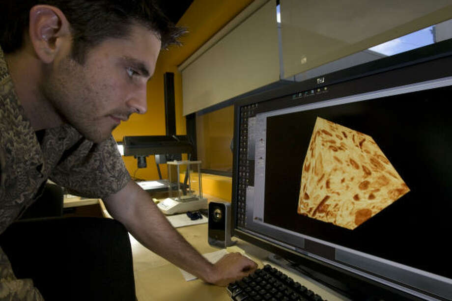 InGrain geologist Jacob Proctor uses imaging technology to examine a rock's elements. Photo: Johnny Hanson, Chronicle