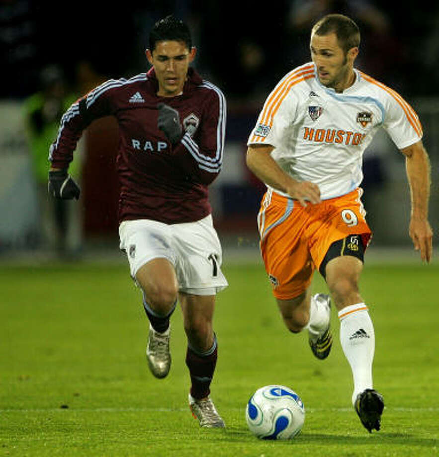The Dynamo's Brian Mullan (right) debuted with Los Angeles in 2001. Photo: Doug Pensinger, Getty Images