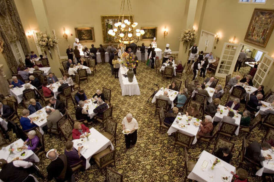 Residents Of The Conservatory Senior Living At Champion Forest Eat Dinner  During The Grand Opening Ceremony