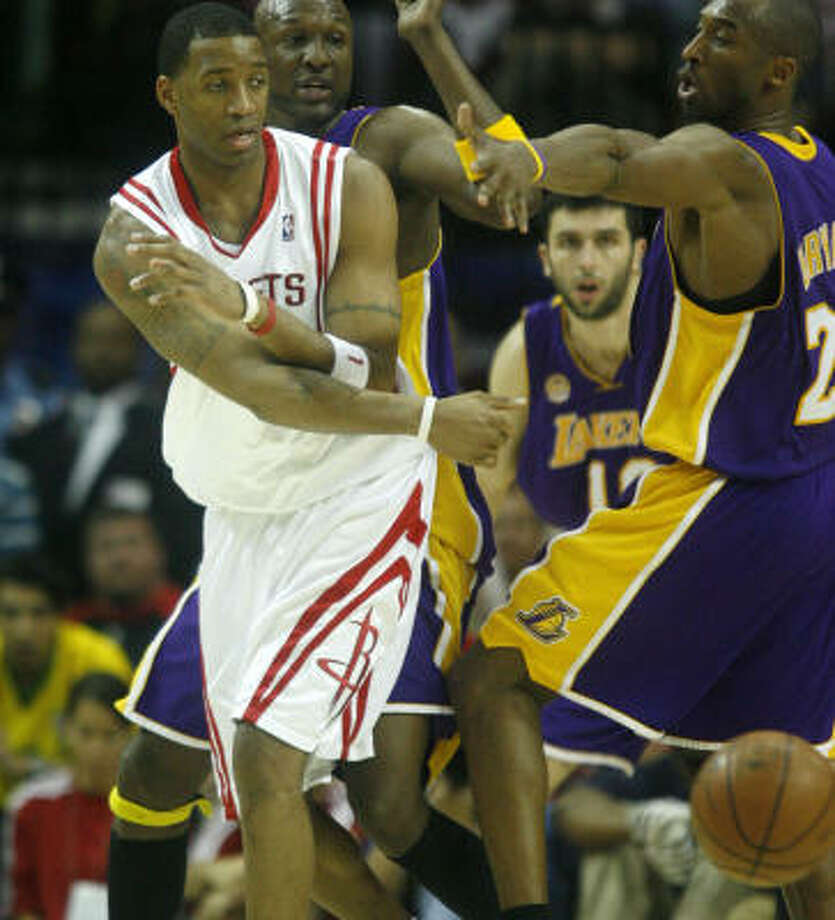 Tracy McGrady beats a double team with a pass. Photo: Karen Warren, Chronicle