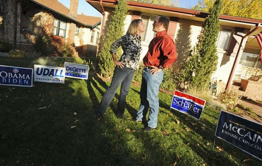 Carolyn Blue is a die-hard Democrat, and her husband, Geoff, will be voting Republican this year. Their yard is split by political signs. In their Democratic neighborhood, Geoff, former president of the Denver Metro Young Republicans, is in the minority, but he said his largely Democratic neighbors are respectful. Photo: RJ SANGOSTI, DENVER POST