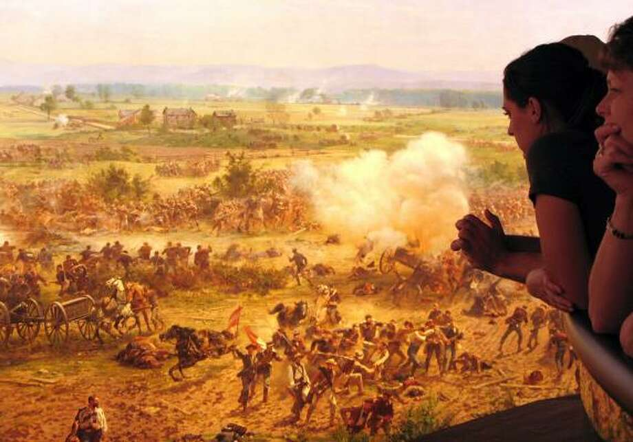 Tourists study French painter Paul Philippoteaux's newly restored Cyclorama painting The Battle of Gettysburg at the new Gettysburg Museum in Pennsylvania. Photo: KARIN ZEITVOGEL, AFP/GETTY IMAGES