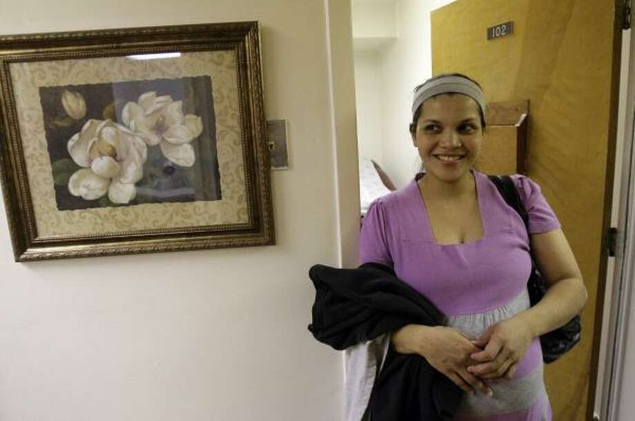 Claudia Cruz waits to see her obstetrician on Monday. Since Hurricane Katrina, childbirth Medicaid expenses have mushroomed. Photo: ALEX BRANDON, ASSOCIATED PRESS
