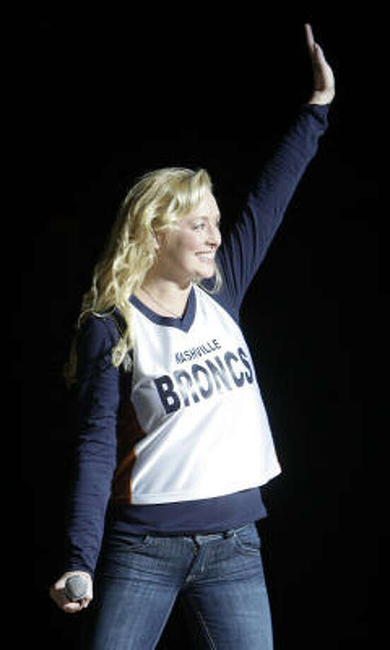 Country singer Mindy McCready waves to the crowd as she is introduced at a Nashville Broncs basketball game Nov. 14 in Nashville, Tenn. Nashville police say McCready has been hospitalized after an apparent suicide attempt. Photo: Mark Humphrey, AP