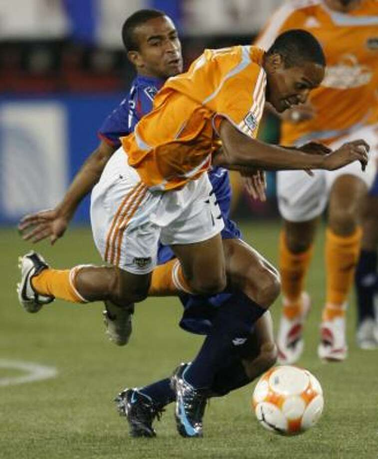 CSD Municipal's Freddy Thompson, left, trips the Dynamo's Ricardo Clark during the first half. Photo: KEVIN FUJII, CHRONICLE