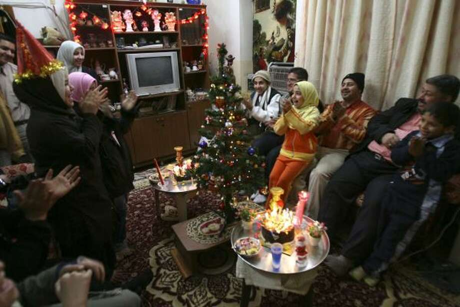 An Iraqi family celebrates in Baghdad. Meanwhile, two of the capital city's landmark hotels hosted high-end parties. Photo: HADI MIZBAN, ASSOCIATED PRESS
