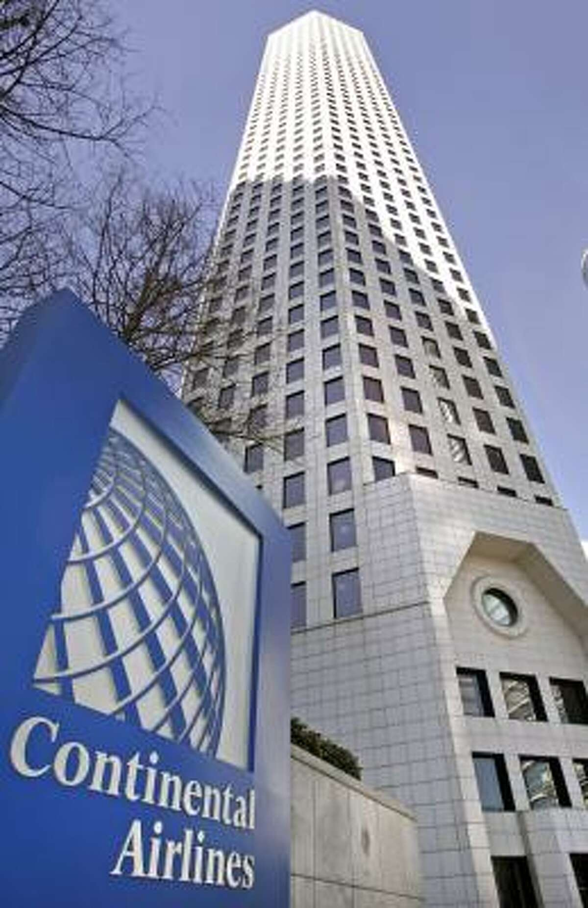 Continental Airlines' downtown building is one of 22 Fortune 500company headquarters in Houston. Experts differ on the importance of the airline continuing to call Houston its home.