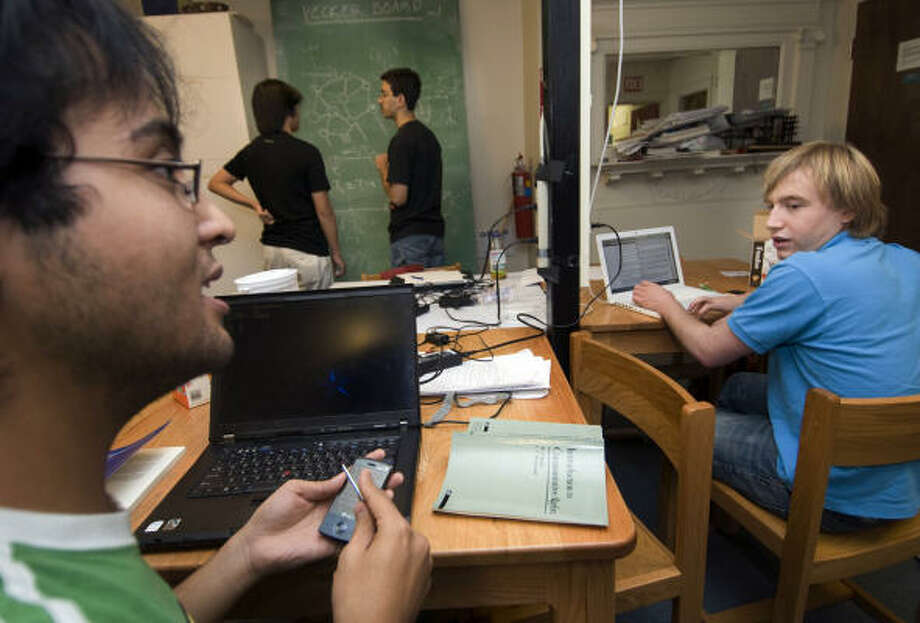 BEING TRACKED: MIT students talk in a dorm in Cambridge, Mass. About 100 students are trading their privacy for a smartphone that tracks their calls, messages and movements. Photo: Jodi Hilton, New York Times