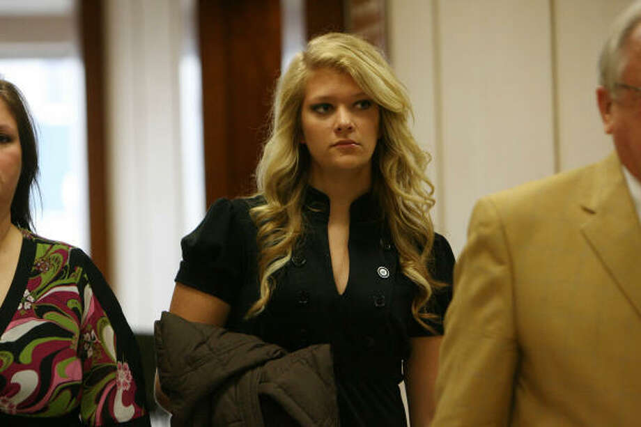 Hannah Rose Cochran walks next to her lawyer after court on Wednesday. Photo: Mayra Beltran, Houston Chronicle