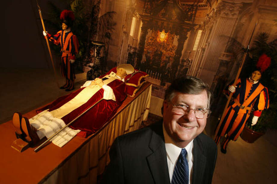 Bob Boetticher, president and vice chairman of the National Museum of Funeral History, stands near an exhibit of a pope lying in repose inside St. Peter\u2019s Basilica with Swiss Guards.  The museum will open the only permanent exhibit of papal artifacts outside the Vatican Tuesday. Photo: Sharon Steinmann, Chroncile
